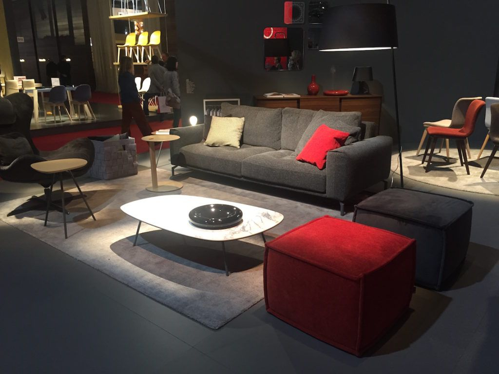Just one red pillow and ottoman make a huge impact in this room.