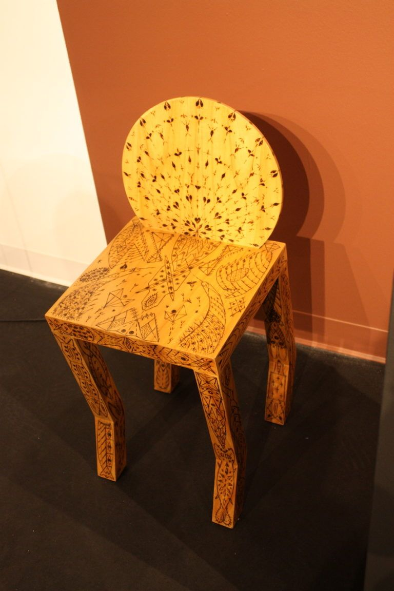 The chair is made from Cedar, who the design etched via pyrogravure.