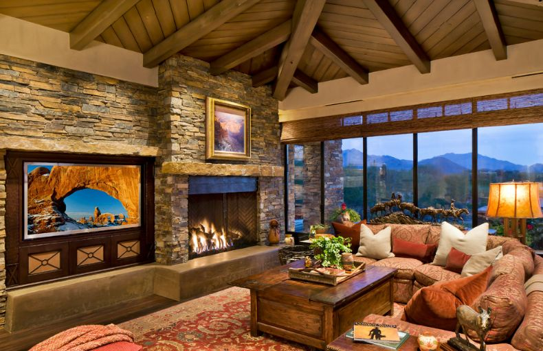 Chalet living room design with a stone stacked fireplace