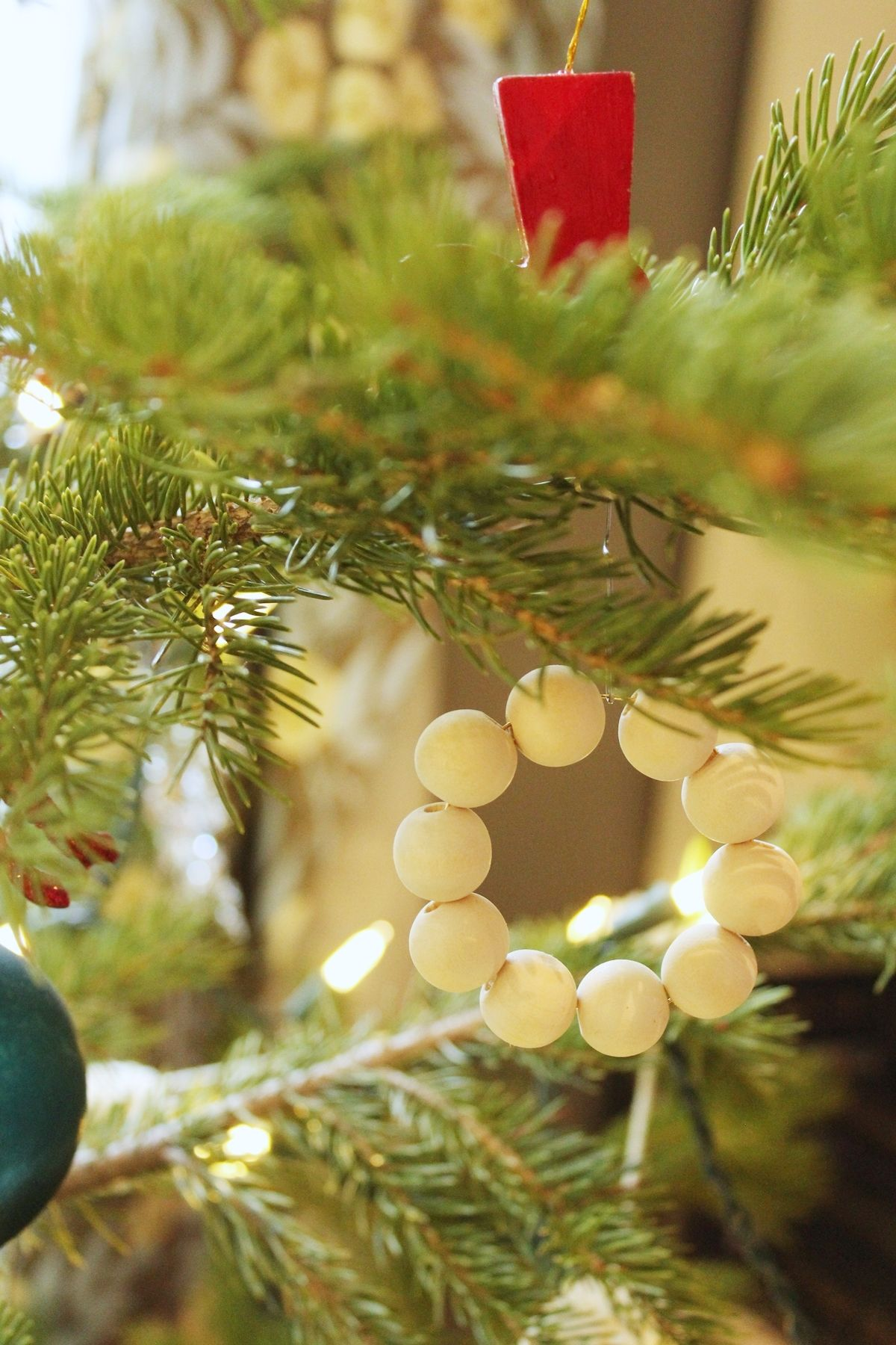 DIY Scandinavian Wooden Ornaments - mini wreath on tree