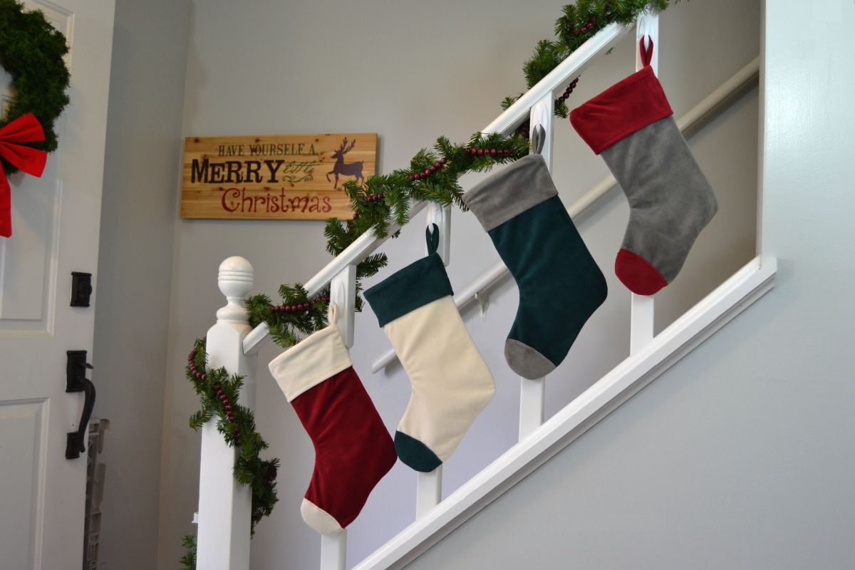Decorate the staircase railing with stocking