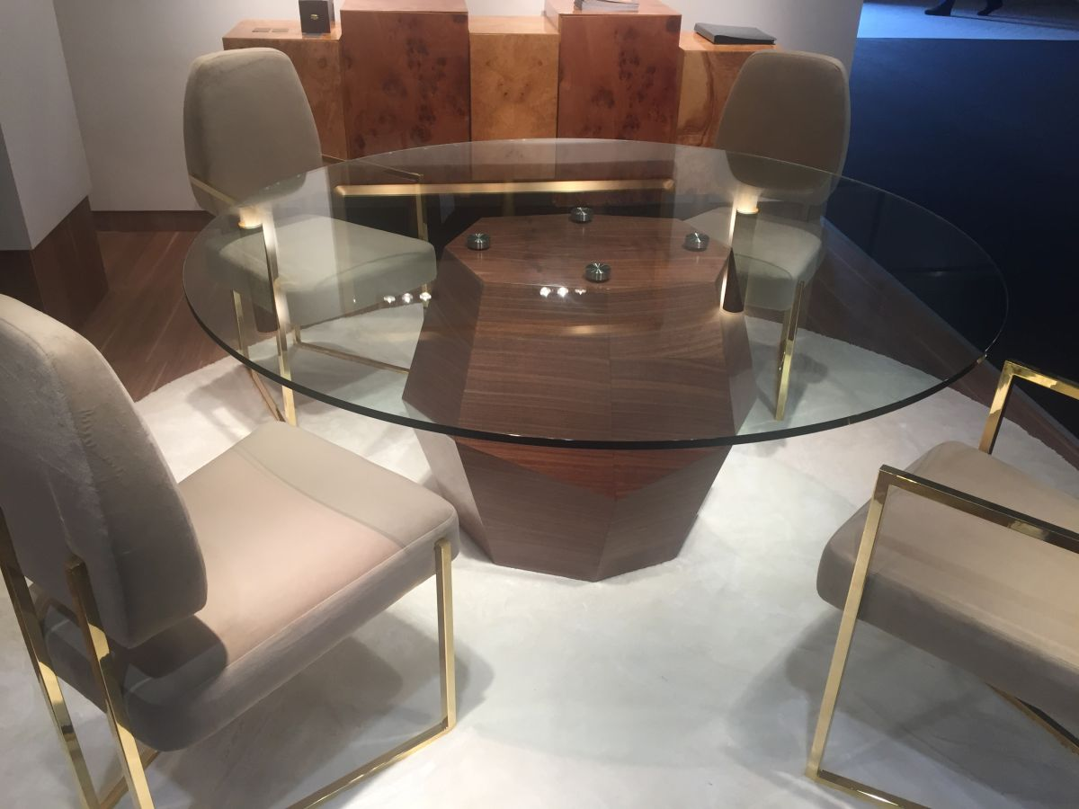 Glass top dining table with armless gold chairs