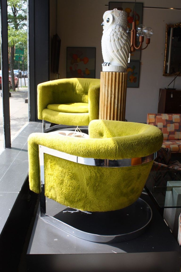 Green living room armchairs