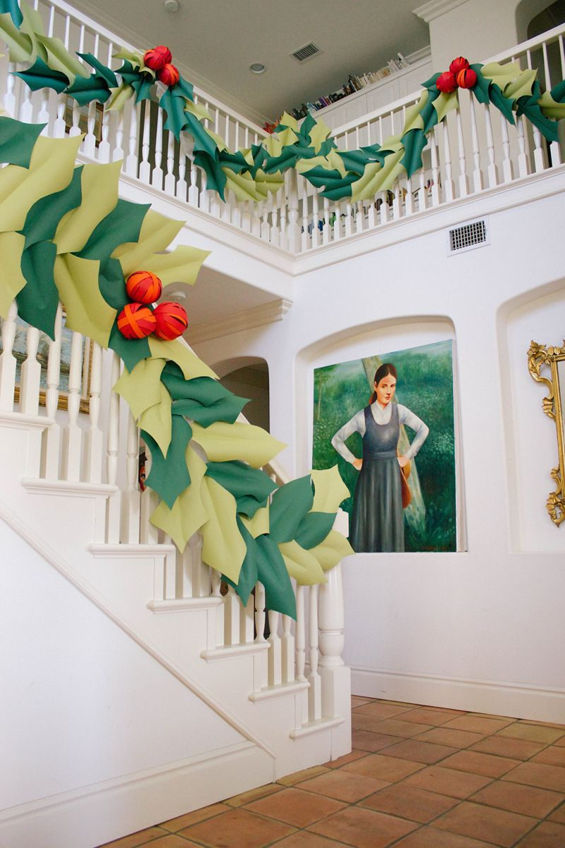 Green oversized garland to decorate the staircase