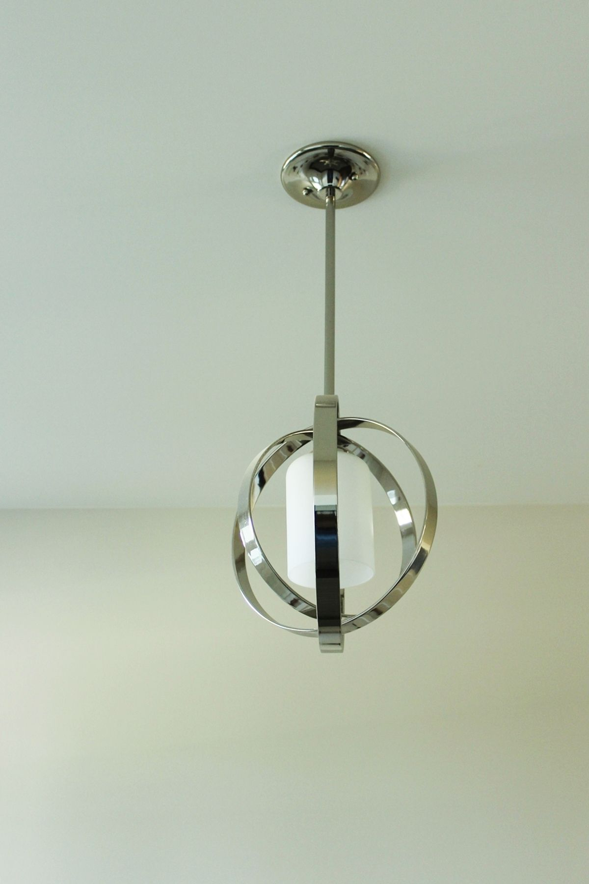 How to Decorate Entryway - simple chrome orb pendant brings