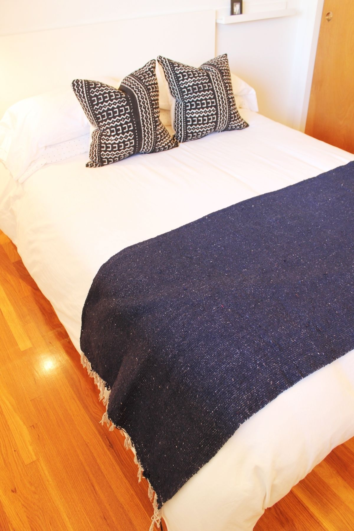 How to Make a Bed - navy throw folded