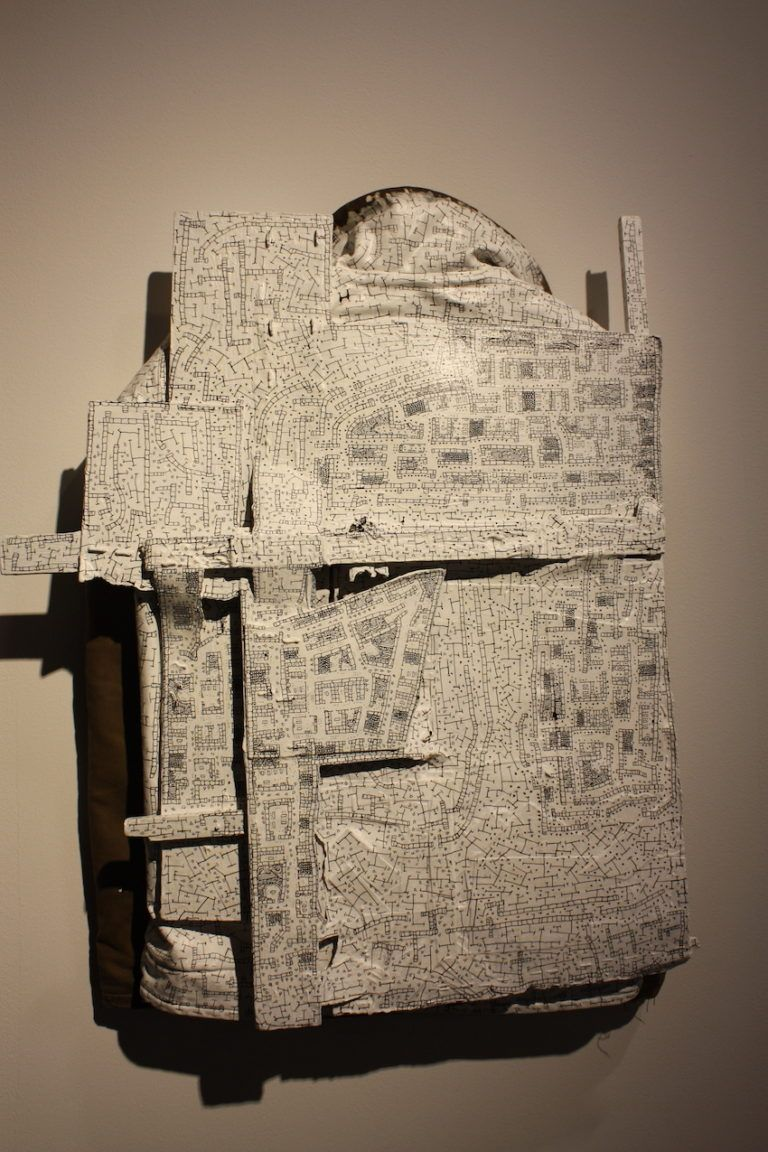 The piece comprises a jacket, wood, acrylic and ink