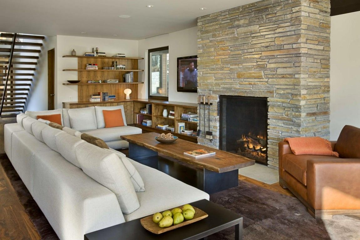 Living room with a modern stacked fireplace