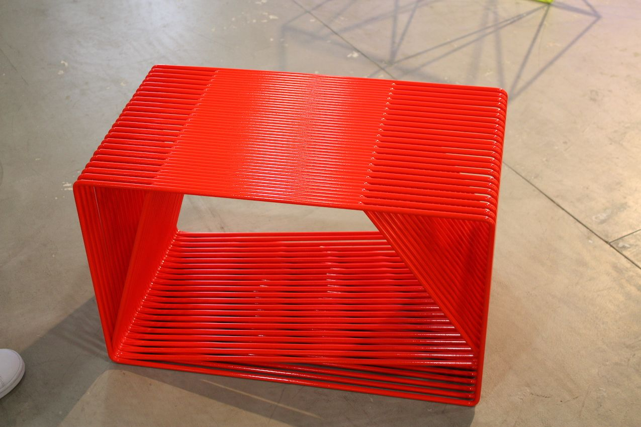 TJ O'Keefe's modern and geometric side table is modern and extra vivid.