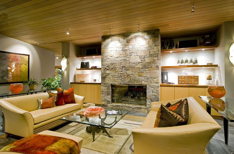 modern living room with stacked fireplace stone design