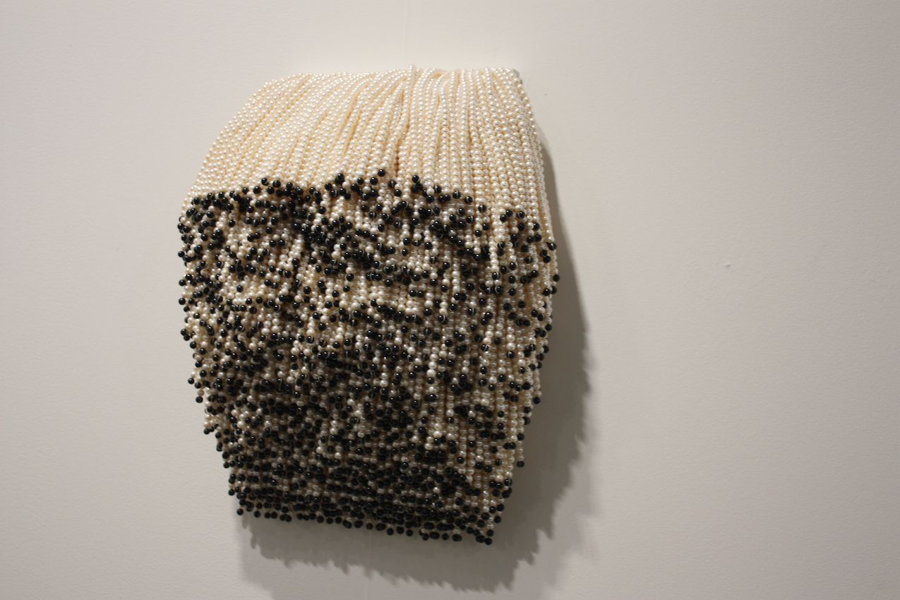 The piece consists of plastic beads.