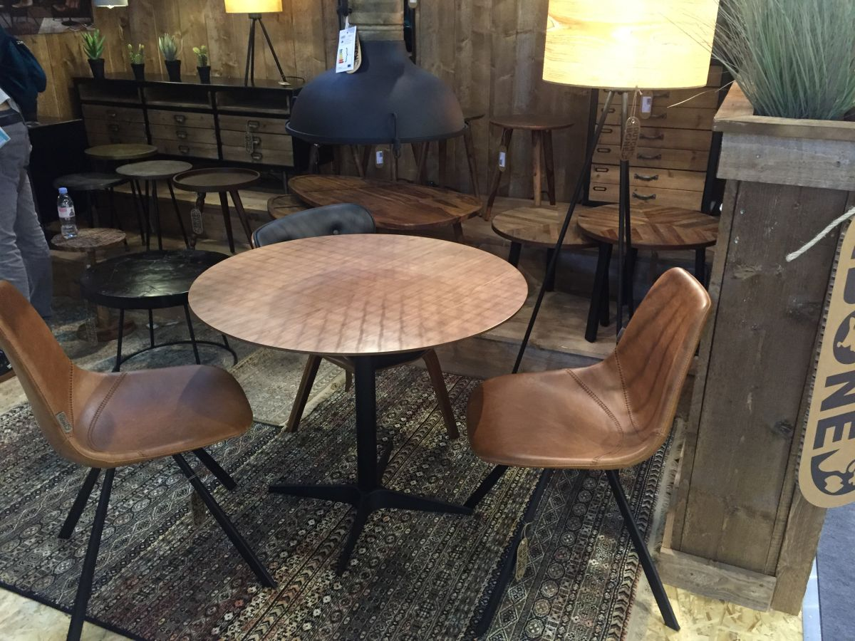 Round Dining Area with Leather Brown Armless Chair