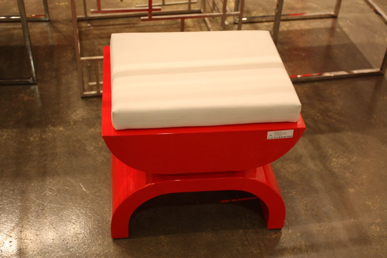 Glossy and bright, this sleek stool is a fantastic accent from Light and Living.