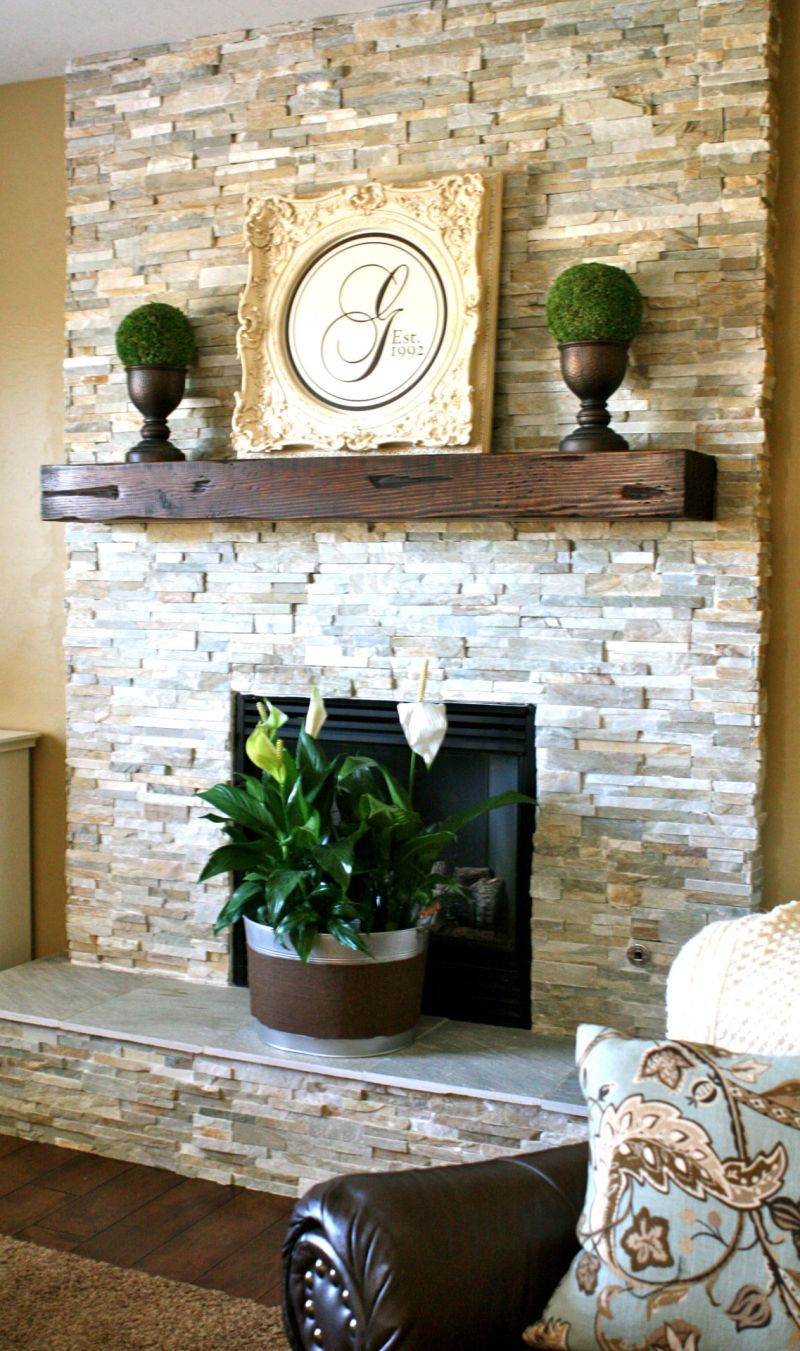 Stacked white fireplace stone with wood log