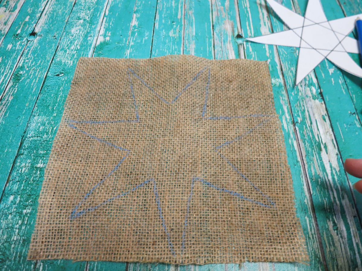 Traced star on burlap