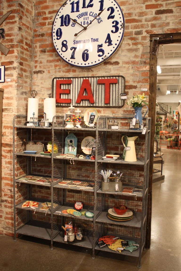 A vintage sign from VIP Home and Garden is the perfect accent against the brick wall.