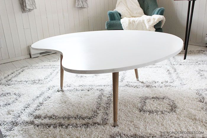 White top coffee table with mid century legs