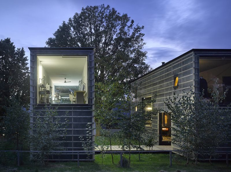 A Zen House Divided In Two Separate Volumes Linked By A Bridge