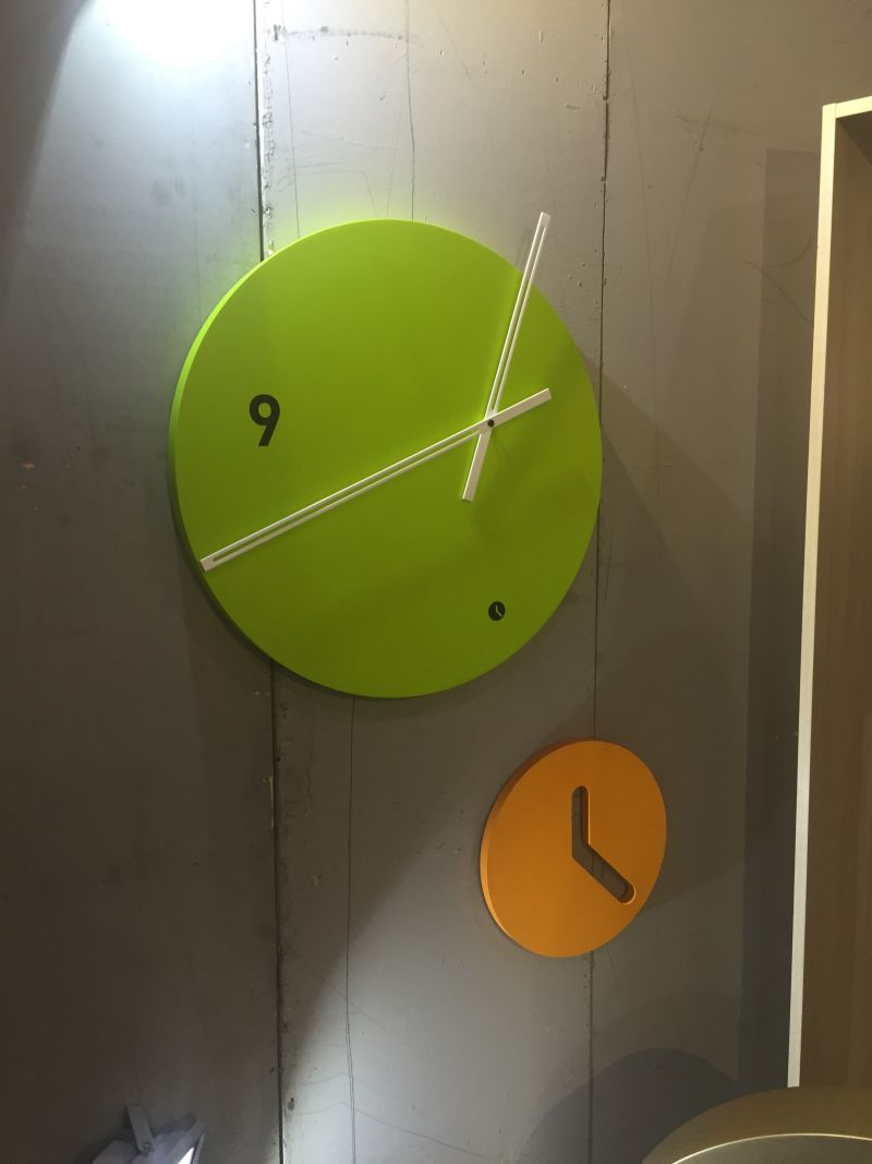 asymmetric wall clock in greenery