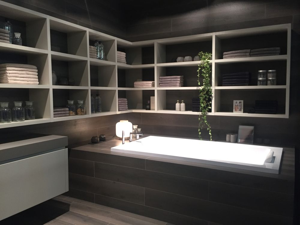 Bathroom bathtub and storage shelf above