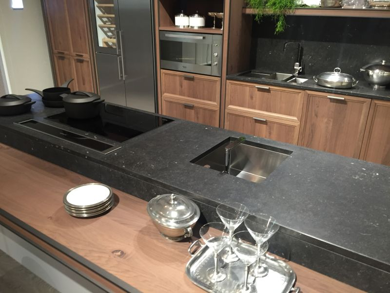 Black marble countertop and brown earth color cabinet