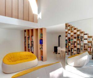 Cozy Parisian Home Organized Through Bookshelves