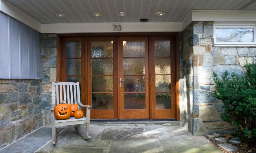 Brown front doors with rain glass