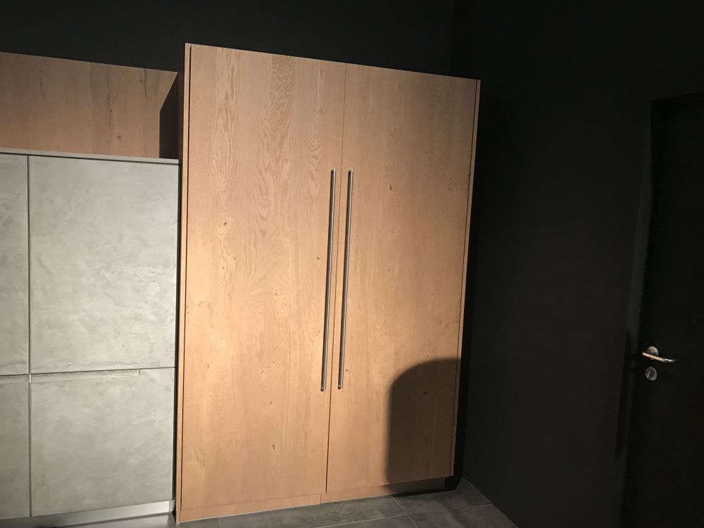 You can hide a lot of clutter behind some large kitchen doors like these ones - a great way to maintain a neat appearance