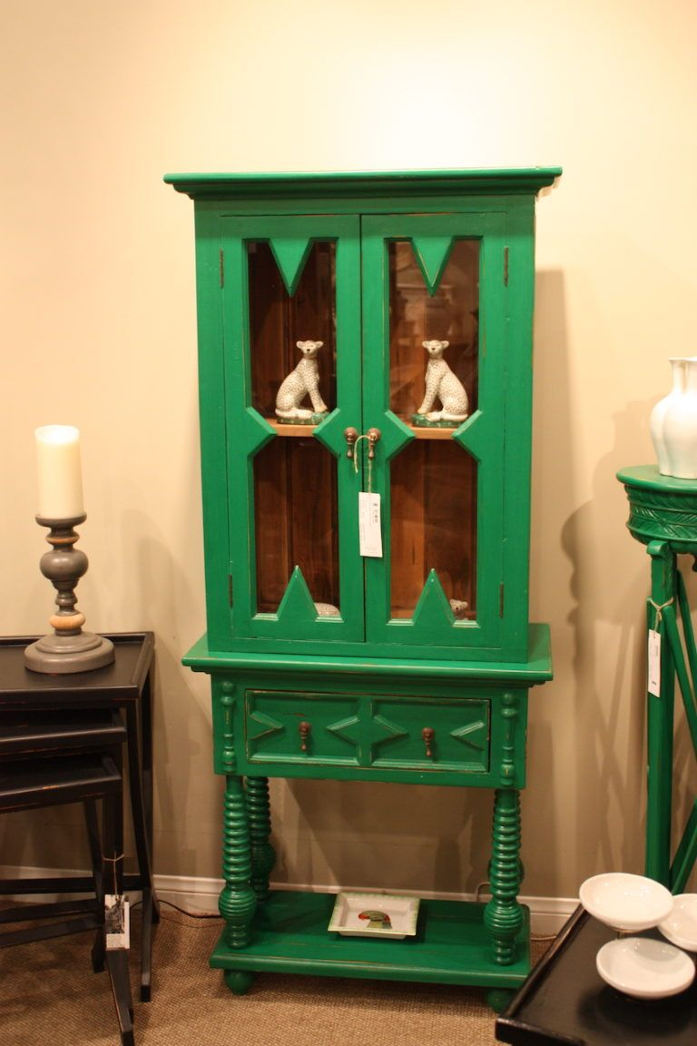 Choose a green painted cupboard for a shot of Jungalow style.