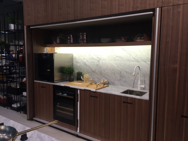 In some configurations it can even be possible to conceal the entire kitchen behind sliding or pocket doors