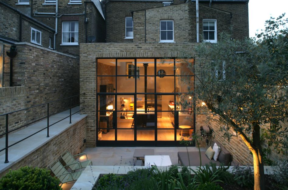 Beautiful designs framed by black window trims - English style window boxes living facades ...