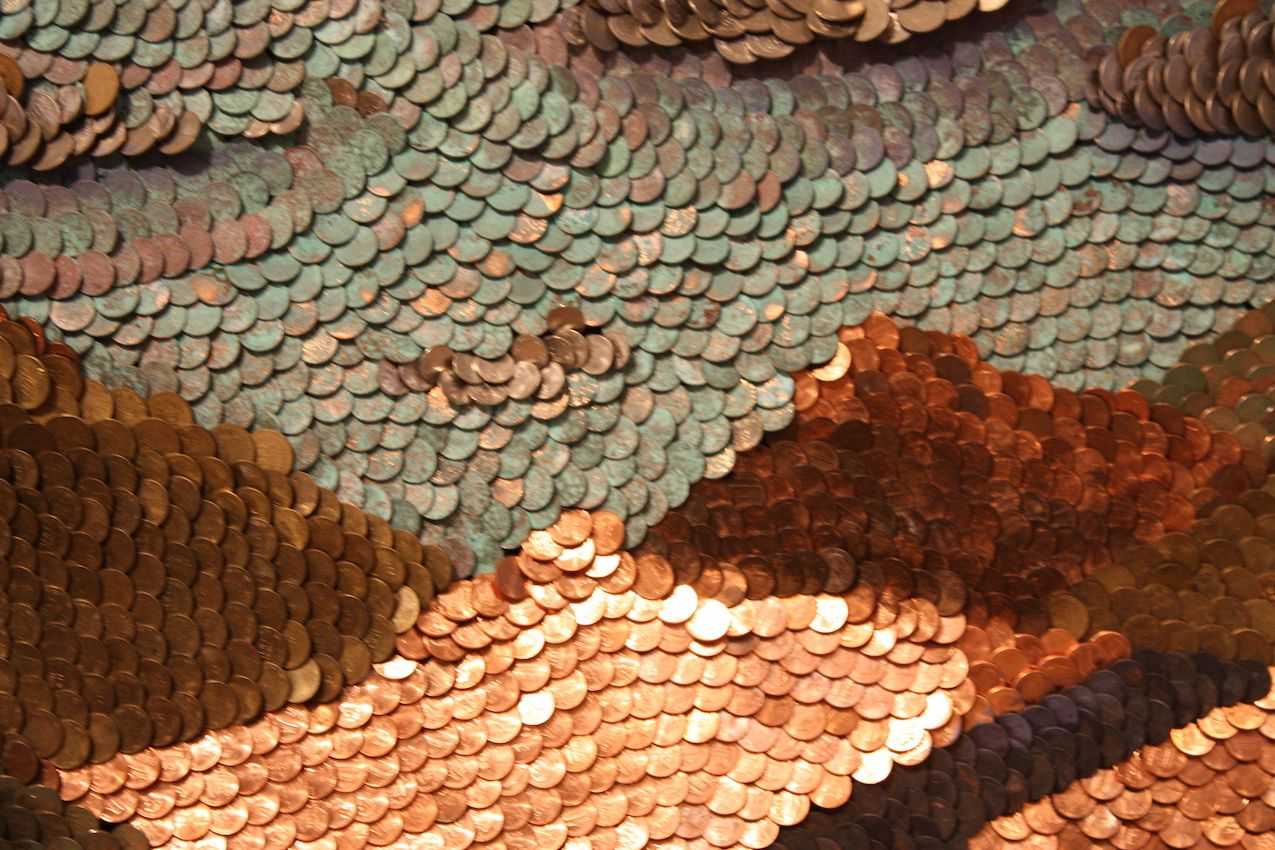 Uribe's piece consists of copper coins in various states of age and patina.