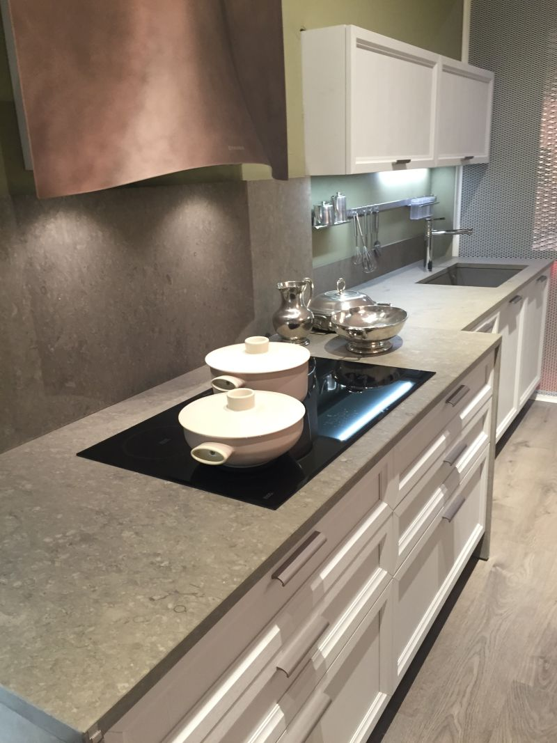 Induction cooktop and grey marble countertop - curverd hood