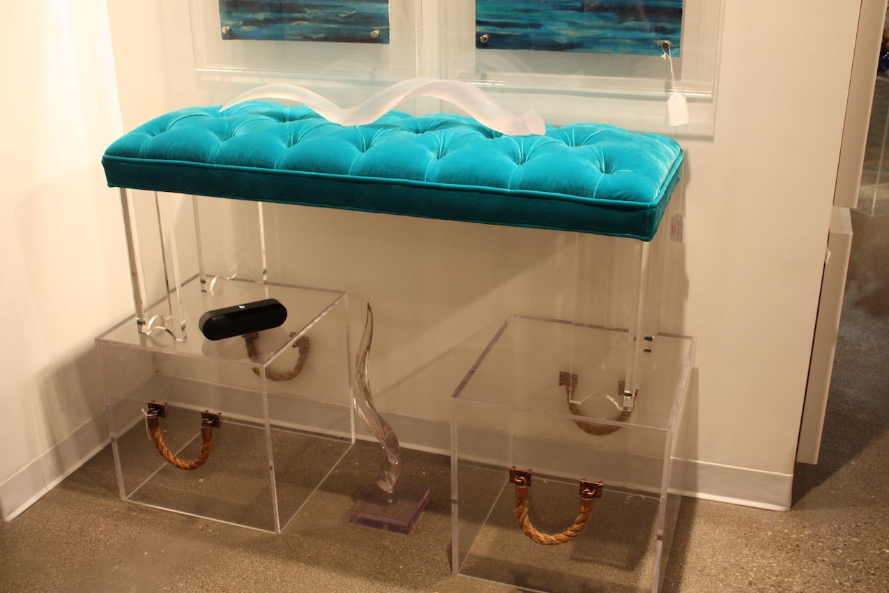 Combining acrylic with a jewel tone like turquoise ups the luxury feel.