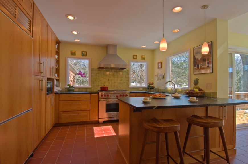 Kitchen Peninsula with modern wood stools
