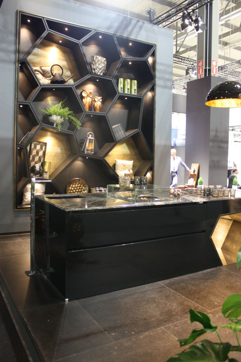 Kitchen in black with honeycomb shelves