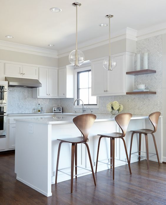 Kitchen interior design with a white design and peninsula