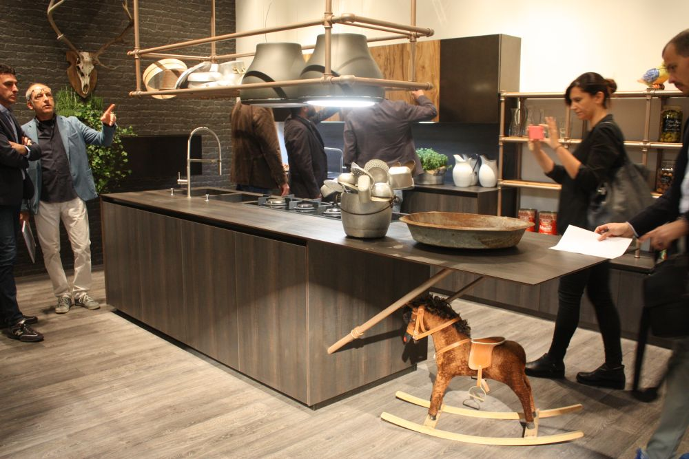 Kitchen with industrial pipes systems above countertop