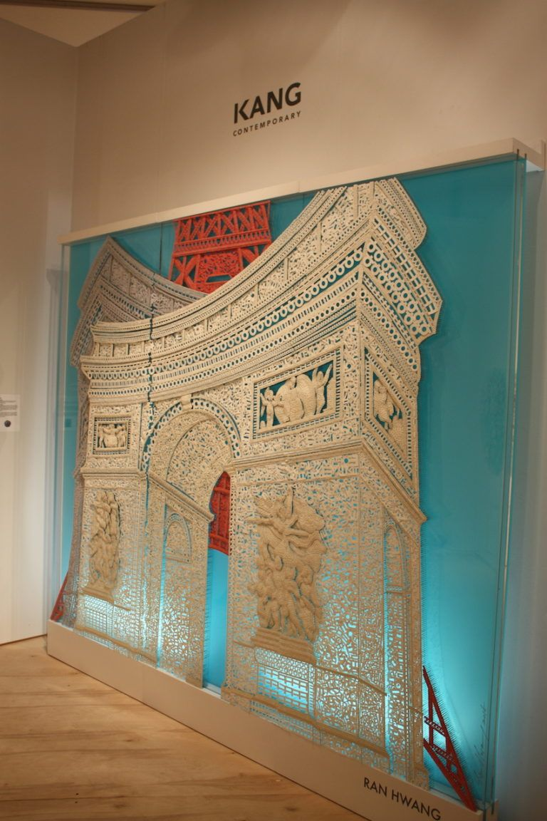 This is composed of paper Hangul Buttons, Pins, and beads on plexiglass.