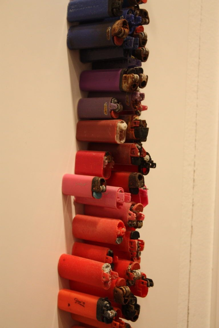 Lighters of many sizes were salvaged for the piece.