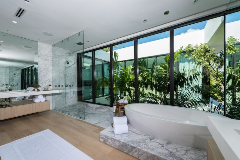 The bathrooms are just as fresh and vibrant, this one in particular given its proximity to the interior courtyard