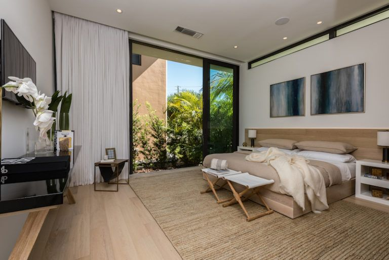 Once again, the bedroom has sliding glass doors that connect it to the outdoors