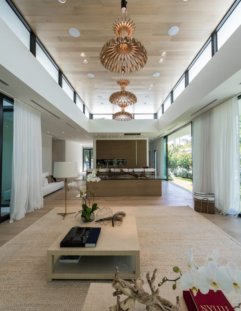 The interior space is organized on two floors, each with its own set of rooms and functions