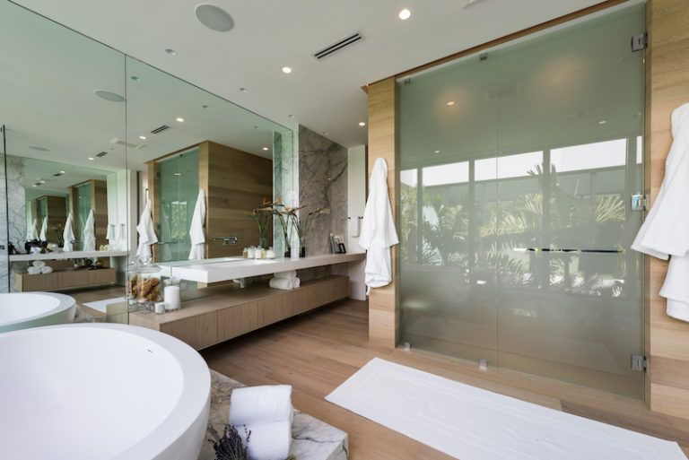 Glass was preferred for the shower enclosures for its transparency and versatility