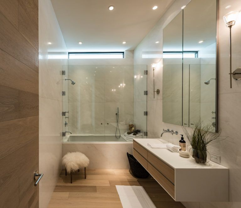 Some bathrooms are quite small and feature a tub and shower combo for a space-efficient layout