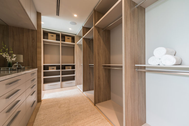A large walk-in closet takes care of the owners' storage needs and provides the perfect environment for good organization