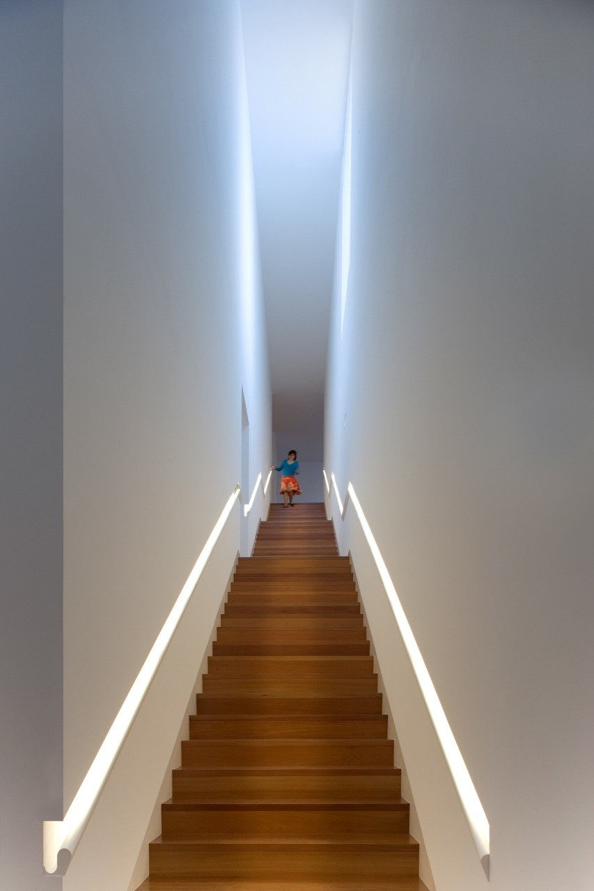 Narrow staircase with built in handrail and LED lights
