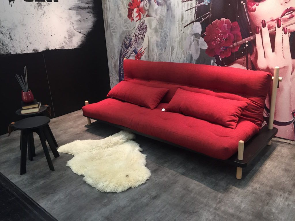 A red futon for your living room or spare room.