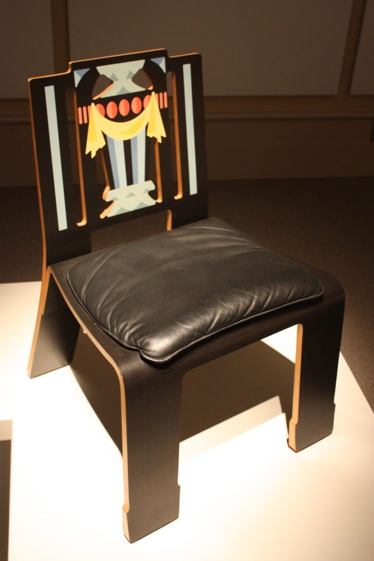 The chair is screen-printed laminate over plywood with a leather seat.