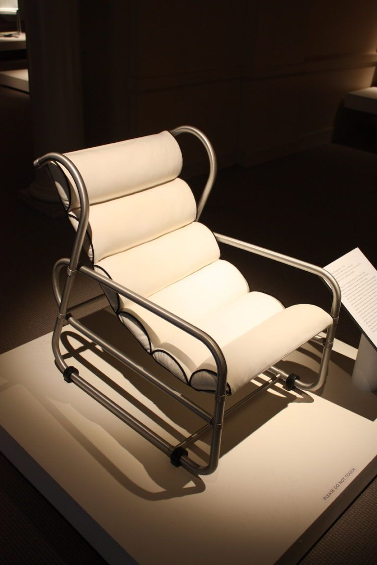 The chair is made from anodized aluminum, rubber and upholstery.